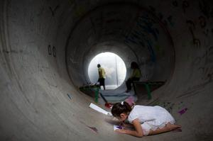 NITZAN, ISRAEL - NOVEMBER 19:  (ISRAEL OUT)  An Israeli child plays in a large concrete pipe used as a bomb shelter on November 19, 2012 in Nitzan, Israel. According to reports November 19, 2012, at least 90 Palestinians have been killed and more than 700 wounded during the Israeli offensive in the Gaza Strip.  (Photo by Uriel Sinai/Getty Images)