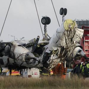 The wreckage of the Manx2 plane in which six people were killed is removed from the runway at Cork Airport