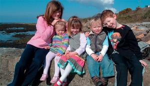 Happy family snap shows Madeleine McCann, centre, with her family at a Donegal resort
