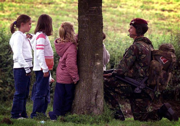 Drumcree - July 6th 2002. Soldiers erect a security fence at Drumcree Church in Portadown.