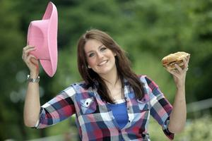 Cow girl Gillian Lewers jumps up for the 'Uptown Hoedown'