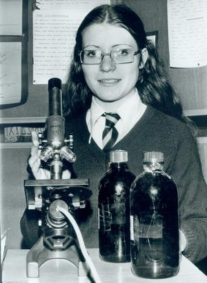 """St Dominic's- A novel experiment on the connection between cigarette smoke and lung cancer has won a Belfast schoolgirl a special science prize. Rita Fox (17) is a pupil at St. Dominic's High School, Falls Road, and her project won a """"Highly Commended"""" rosette at the Young Scientist of the Year competition in Dublin, 1975."""