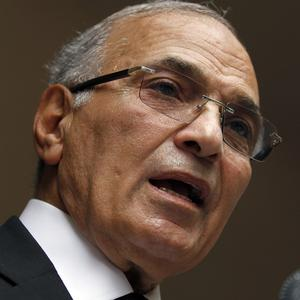 Failed Egyptian presidential candidate Ahmed Shafiq has left the country (AP)