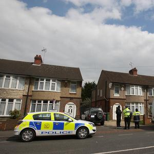 Police remain at a house in Bishopscote Road, Luton