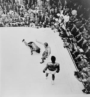 1965: Muhammad Ali, is pushed away to a neutral corner by the referee as challenger Floyd Patterson slumps to the canvas in the sixth. The fight was stopped in the twelth on on November 25, 1965.