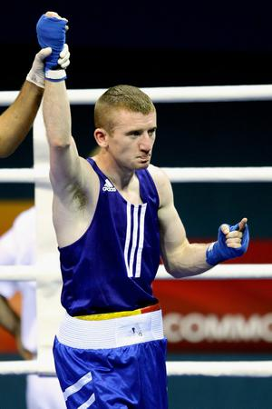 Paddy Barnes of Northern Ireland celebrates winning the gold medal after the Light Fly Weight (46-49kg) Men Finals Gold Medal Bout against Jafet Uutoni of Namibia at Talkatora Indoor Stadium on day ten of the Delhi 2010 Commonwealth Games on October 13, 2010 in Delhi, India