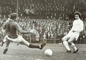Lisburn Distillery's Martin O'Neill puts the ball past Derry keeper McKibben in the opening minutes of the Irish Cup Final at Windsor Park. 03/04/71