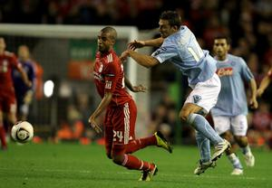 LIVERPOOL, ENGLAND - NOVEMBER 04:  David Ngog of Liverpool competes with Hugo Campagnaro of Napoli during the UEFA Europa League Group K match beteween Liverpool and SSC Napoli at Anfield on November 4, 2010 in Liverpool, England.  (Photo by Clive Brunskill/Getty Images)