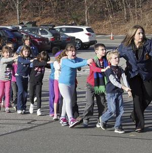Connecticut state police lead children from Sandy Hook Elementary School following the shooting (AP/Newtown Bee, Shannon Hicks)