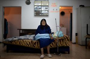 NETIVOT, ISRAEL - NOVEMBER 14:  (ISRAEL OUT) An Israeli woman sits inside a bomb shelter on November 14, 2012 in Netivot, Israel. Israel Defense Forces launched aerial attacks on targets in Gaza that killed the top military commander of Hamas, (Photo by Uriel Sinai/Getty Images)