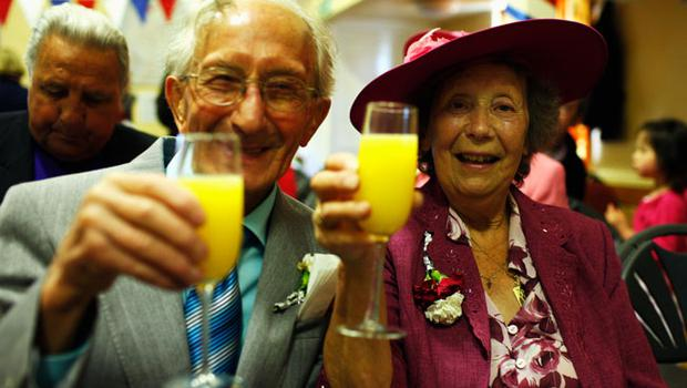 YARDLEY HASTINGS, UNITED KINGDOM - APRIL 29 :   Residents of Yardley Hastings Vera White, aged 82, and Raymond White, aged 85, and married for 62 years, enjoy a champagne breakfast as they prepare to celebrate the royal wedding on April 29, 2011 in  Northamptonshire, United Kingdom.  The marriage of Prince William, the second in line to the British throne, to Catherine Middleton is being held in London today. The Archbishop of Canterbury conducted the service which was attended by 1900 guests, including foreign Royal family members and heads of state. Thousands of well-wishers from around the world have also flocked to London to witness the spectacle and pageantry of the Royal Wedding and street parties are being held throughout the UK. (Photo by Mark Thompson/Getty Images)