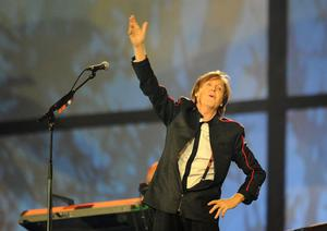 Paul McCartney performs during the London Olympic Games 2012 Opening Ceremony at the Olympic Stadium, London. PRESS ASSOCIATION Photo. Picture date: Friday July 27, 2012. See PA story OLYMPICS Ceremony. Photo credit should read: Owen Humphreys/PA Wire. EDITORIAL USE ONLY
