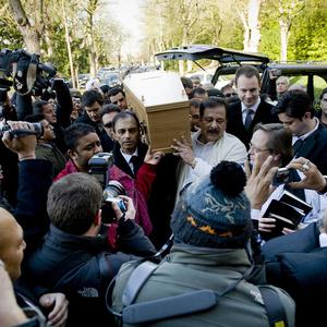 Pall bearers carry the coffin of Indian actor Dev Anand as it arrives at the Putney Vale Crematorium in London (AP)