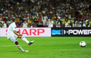 KIEV, UKRAINE - JUNE 24:  Ashley Cole of England takes his penalty during the shoot out during the UEFA EURO 2012 quarter final match between England and Italy at The Olympic Stadium on June 24, 2012 in Kiev, Ukraine.  (Photo by Laurence Griffiths/Getty Images)