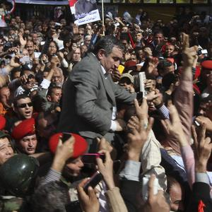 Essam Sharaf is greeted by supporters after giving a speech in Cairo (AP)