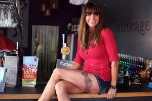Bonnie Turkington aged 44 who owns Birdcage Restaurant on the Stranmillis Road, showing off her tattoo
