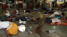 ** EDS NOTE GRAPHIC CONTENT ** Luggage of passengers lie scattered on a blood splattered platform at the Chhatrapati Shivaji Terminus railway station in Mumbai, India, Wednesday, Nov. 26, 2008. Police say several people have been wounded in a series of attacks by terrorist gunmen at seven sites in Mumbai, including two luxury hotels. A.N. Roy, a senior police officer, says police were battling the gunmen. (AP Photo)