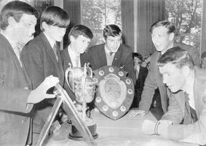 Billy McCullough (right), of Glentoran, and Ewan Fenton (second right), manager of Linfield, two of the soccer personalities who attended the presentation of soccer medals and trophies at Dunlambert Boys' Secondary School, Belfast. Also in the picture are four captains (from left)- Christopher McGrath, junior team; John Flanagan, intermediate; George Hawthorne, senior, and Sam Higgins, colts, 1968.