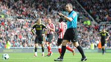 Referee Kevin Friend awards a penalty for Liverpool against Sunderland on Sunday having initially given a free kick