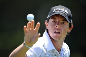 DALY CITY, CA - JUNE 11:  Rory McIlroy of Northern Ireland catches a golf ball during a practice round prior to the start of the 112th U.S. Open at The Olympic Club on June 11, 2012 in Daly City, California.  (Photo by Stuart Franklin/Getty Images)