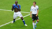 Mario Balotelli (left) of Italy celebrates scoring the opening goal as Philipp Lahm of Germany shows his dejection during the UEFA EURO 2012 semi final match between Germany and Italy at the National Stadium on June 28, 2012 in Warsaw, Poland