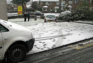 This photograph was taken at Killymoon Street Cookstown on 29 October 1.30pm. I was working in my office when all of a sudden I heard this bang. I looked out the window and saw this car sitting in our lawn. Apparently the driver tried to avoid sliding into the back of another car and decided our garden would be a softer landing spot; so she drove over our wall and landed her car in it!! Nobody was hurt and the car has been safely 'lifted' out. Picture by Liam Currie