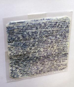 A letter written by Kieran Doherty on cigarette paper which was smuggled out of the prison pictured at the exhibition