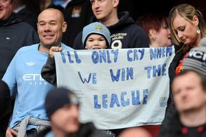 LONDON, ENGLAND - APRIL 08:  A young Man City fan holds up a banner during the Barclays Premier League match between Arsenal and Manchester City at Emirates Stadium on April 8, 2012 in London, England.  (Photo by Michael Regan/Getty Images)