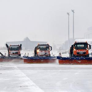 Snowploughs clear the snow from the tarmac at the airport Leipzig/Halle in Schkeuditz, eastern Germany (AP)