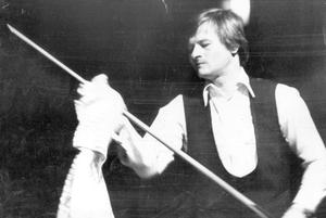 Alex Higgins.  Snooker Legend.  A familiar sights for snooker fans... Irish professional champion Alex Higgins wiping his cue with a towel during last night's title match against Dennis Taylor in the Ulster Hall.  Higgins won the first session 7-2 in the 41 frame decider which is being presented by the 'Belfast Telegraph' and Kearney Promotions.    (03/02/1978)