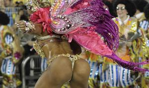 EDS NOTE NUDITY - A dancer performs during the parade of  Aguia de Ouro samba school in Sao Paulo, Brazil, Sunday, Feb. 19, 2012. (AP Photo/Andre Penner)