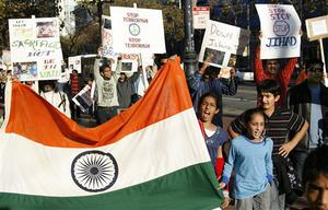 Demonstrators march down Market Street in San Francisco, Sunday, Nov. 30, 2008 with signs and the Indian flag in condemnation of the terrorist attacks in Mumbai, India. (AP Photo/Dino Vournas)
