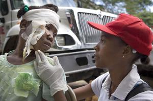 In a Jan. 17, 2010 photo provided by the American Red Cross,American Red Cross volunteer Renette Danger examines Kemsia Louis at a Red Cross medical center in Croix de Priez, Haiti.  (AP Photo/American Red Cross, Talia Frenkel)