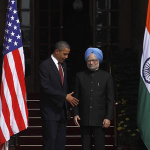 Barack Obama extends his hand to Indian prime minister Manmohan Singh (AP)