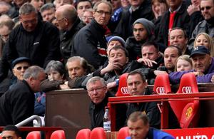 MANCHESTER, ENGLAND - APRIL 22:  Manchester United Manager Sir Alex Ferguson and United fans look on during the Barclays Premier League match between Manchester United and Everton at Old Trafford on April 22, 2012 in Manchester, England.  (Photo by Alex Livesey/Getty Images)