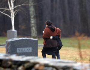 Veronique Pozner, left, embraces a young girl as she arrives at B'nai Israel Cemetery for burial services for her 6-year-old son Noah Pozner, Monday, Dec. 17, 2012, in Monroe, Conn. Noah Pozner was killed when Adam Lanza walked into Sandy Hook Elementary School in Newtown, Conn., Friday and opened fire, killing 26 people, including 20 children, before killing himself. (AP Photo/Julio Cortez)