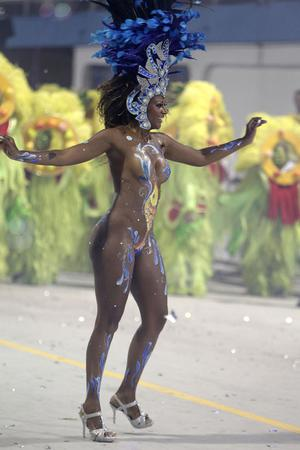 A dancer performs during the parade of  Rosas de Ouro samba school in Sao Paulo, Brazil, Saturday, Feb. 18, 2012. (AP Photo/Andre Penner)