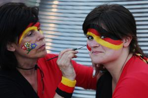 KHARKOV, UKRAINE - JUNE 13:  A Germany fan has her face painted prior to the UEFA EURO 2012 group B match between Netherlands and Germany at Metalist Stadium on June 13, 2012 in Kharkov, Ukraine.  (Photo by Julian Finney/Getty Images)