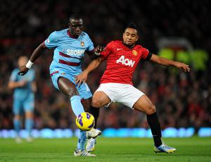 Manchester United's Oliveira Anderson (right) and West Ham United's Mohamed Diame (left) battle for the ball during the Barclays Premier League match at Old Trafford