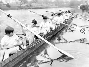 The Methodist College Craig Cup crew push their boat away from the slip at the school boathouse, Stranmillis for a six mile training session on the Lagan. The boys, who are all under fifteen, are training four days each week in preparation for the Craig Cup race at Coleraine in June, 1070.