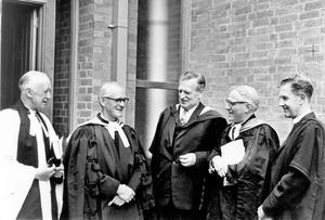 Chapel of Unity dedication at Methodist College. The four clergy, who togeather spoke the Benediction after the dedication of the Chapel of Unity at Methodist College, pictured with the headmaster, Mr. A. Stanley Worrall (centre). They are (from left)- the Dean of Belfast, Very Rev. C. I. Peacocke; the President of the Methodist Church, Rev. Gerald G. Myles; Principal J.L.M. Haire, and Rev. R. G. Bagnall, chaplain of the college, 1968.