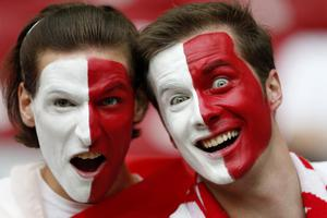 Polish supporters cheer prior to the Euro 2012 soccer championship Group A match between Poland and Russia in Warsaw, Poland, Tuesday, June 12, 2012. (AP Photo/Michael Sohn)