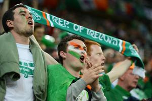 GDANSK, POLAND - JUNE 14: Republic of Ireland fans sing during the UEFA EURO 2012 group C match between Spain and Ireland at The Municipal Stadium on June 14, 2012 in Gdansk, Poland.  (Photo by Jasper Juinen/Getty Images)
