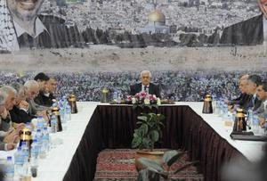 RAMALLAH, WEST BANK - NOVEMBER 18: In this handout image supplied by the office of the Palestinian president, Palestinian President Mahmoud Abbas conducts a meeting of the Palestinian leadership on November 18, 2012 in Ramallah, West Bank. Abbas has reportedly reached out to Arab and Western leaders for aid in the face of the heightening conflict between Israel and Gaza.  (Photo by Thaer Ghanaim /PPO via Getty Images)
