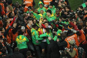 Sergio Ramos of Spain lifts the World Cup trophy amongst a melee of media and security following the 2010 FIFA World Cup South Africa Final match between Netherlands and Spain at Soccer City Stadium on July 11, 2010 in Johannesburg, South Africa