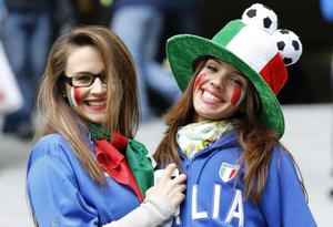 Italian fans smile prior to the Euro 2012 soccer championship Group C match between Italy and Croatia in Poznan, Poland, Thursday, June 14, 2012. (AP Photo/Antonio Calanni)