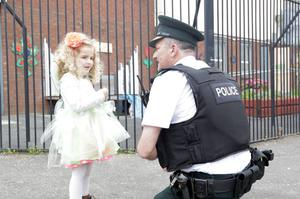 Constable George Kirk chats with a little girl while on the beat in north Belfas