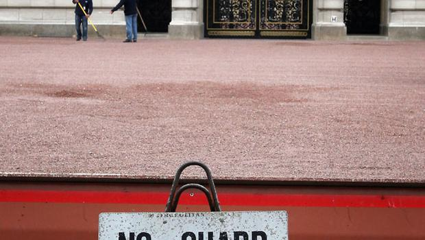 LONDON, ENGLAND - APRIL 28:  Workmen rake gravel on the forecourt of Buckingham Palace on April 28, 2011 in London, England. With less than 24 hours to go final preparations for the wedding of Prince William and Catherine Middleton are in place.  (Photo by Peter Macdiarmid/Getty Images)