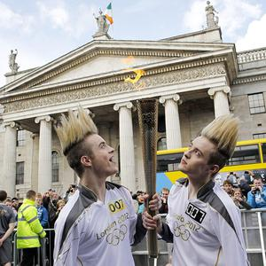 Jedward - John and Edward Grimes - carry the Olympic Flame in Dublin city centre