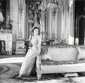 Portrait of Britain's Queen Elizabeth II by Cecil Beaton, wearing a dress designed by Hardy Amies for the State Visit to Germany in 1965.